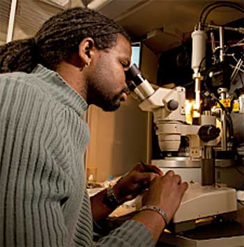 man using microscope photo